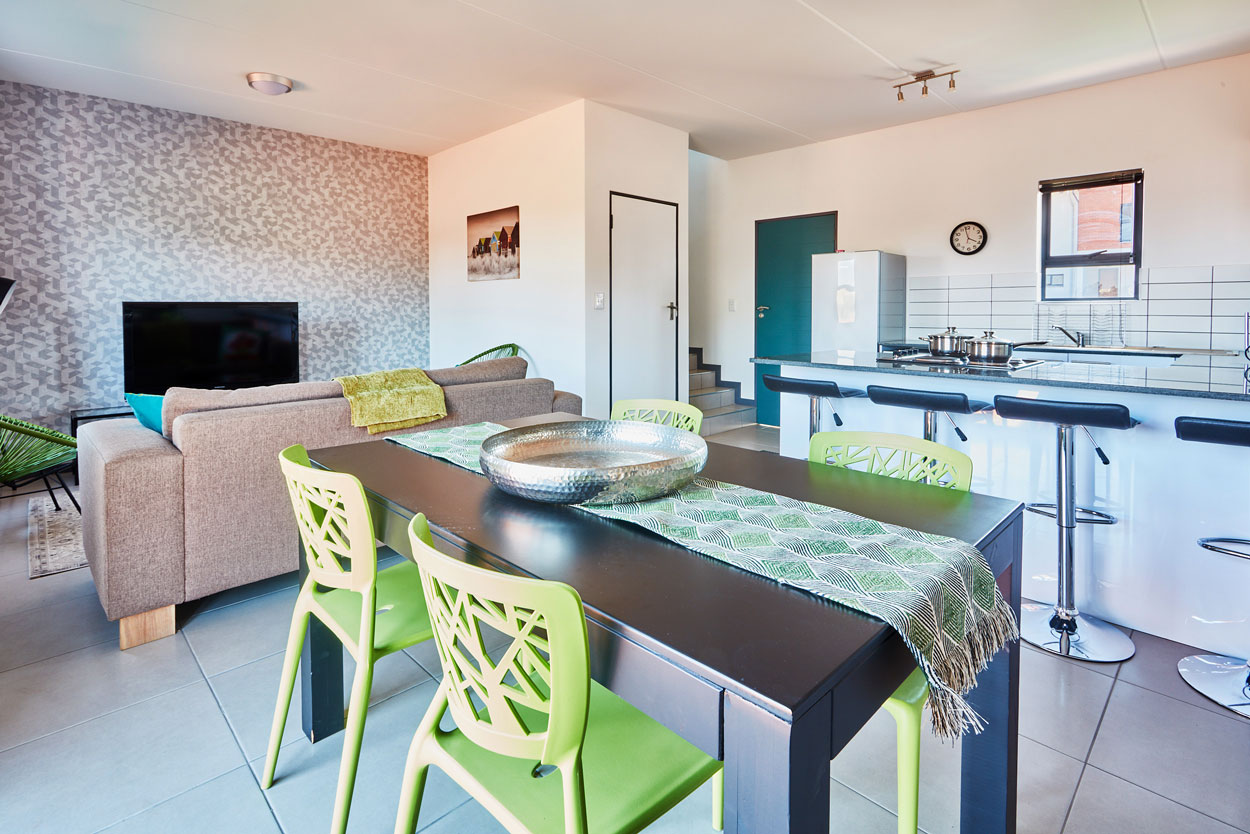 Dining, kitchen and living area open plan view